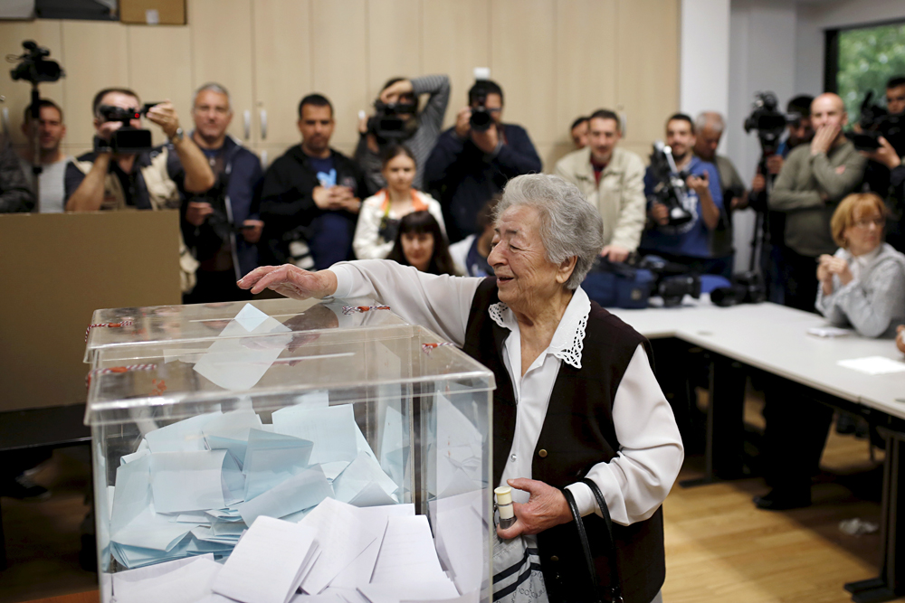 A woman casts her vote at a polling station during elections in Belgrade, Serbia April 24, 2016