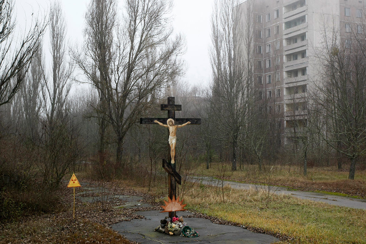 A cross with a crucifix on display in Pripyat. The radioactive pollution caused the deaths of around 4000-200,000 people.