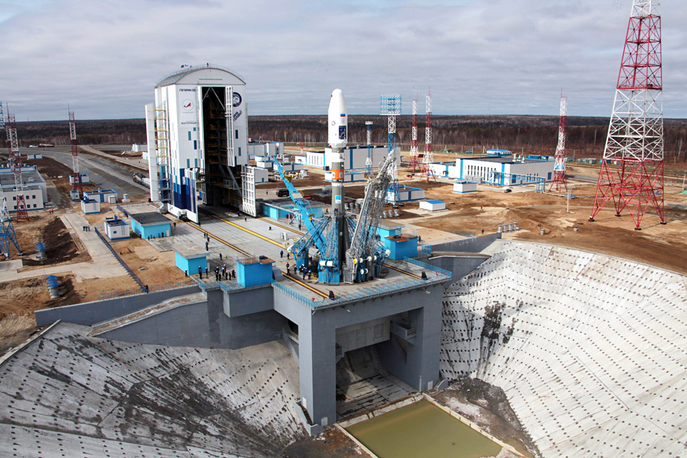 A Soyuz-2.1a rocket booster being installed on a launch pad at the Vostochny cosmodrome. The launch of the rocket carrying three satellites Lomonosov, SamSat-218, and Aist-2D is scheduled for April 27, 2016.