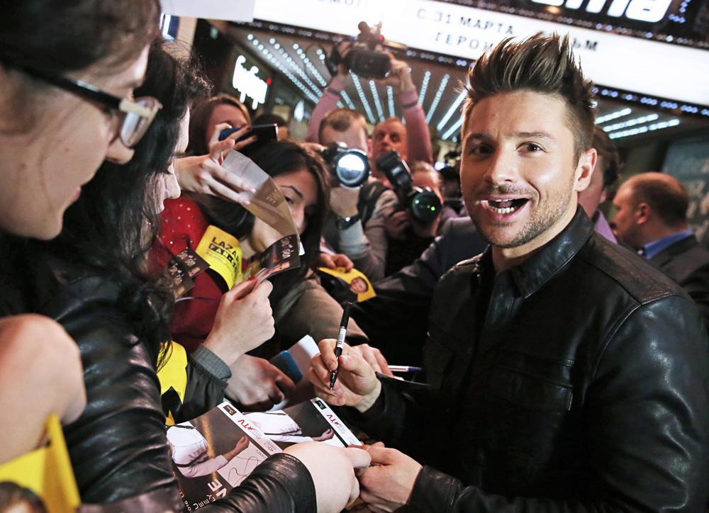 Russian singer Sergey Lazarev signs autographs, Moscow Region.
