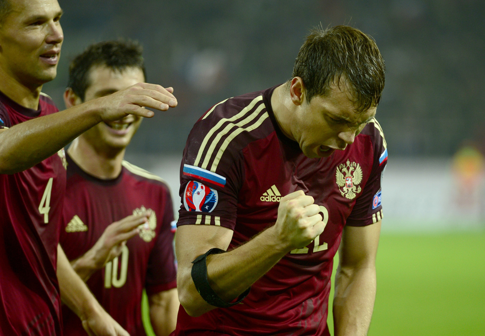 Artem Dzyuba (R) of Russia reacts after scoring a goal during the UEFA Euro 2016 qualifying Group G game between Russia and Moldova at Otkrytie Arena in Moscow, on October 12, 2014.