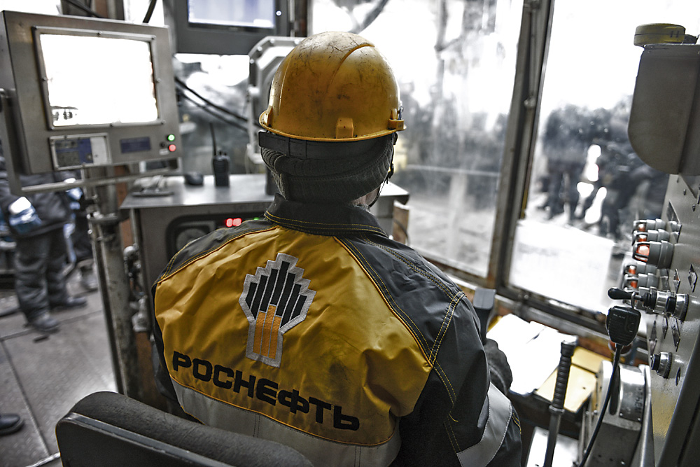 An employee works at the Rosneft Tagul production area, Krasnoyarsk region.