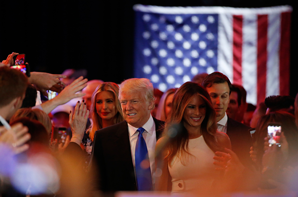 Republican U.S. presidential candidate Donald Trump arrives with his wife Melania at his campaign victory party to speak to supporters after his rival Ted Cruz dropped out of the race following the results of the Indiana state primary, at Trump Tower in Manhattan, New York, U.S., May 3, 2016.
