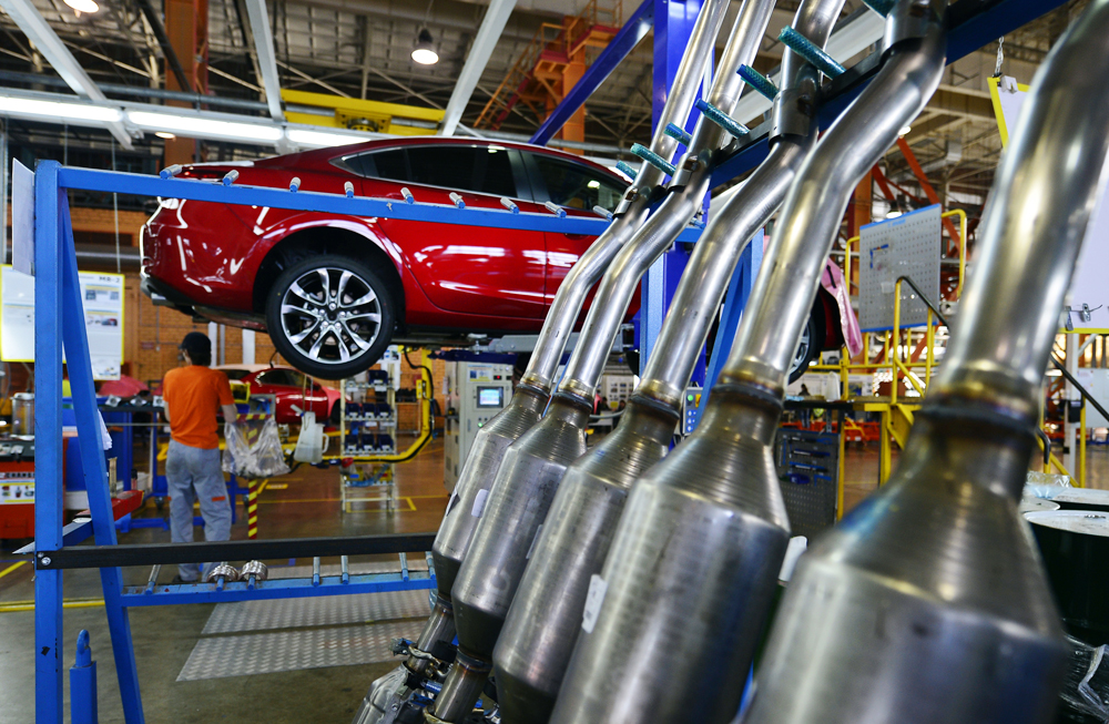 An employee assembles a Mazda 6 car at Mazda Sollers Manufacturing Rus, Russian Japanese joint car assembly plant.