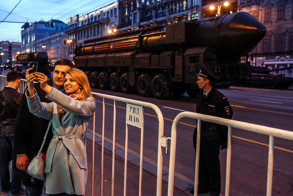 A couple takes a selfie in Moscow during a rehearsal for the 2017 Victory Day parade