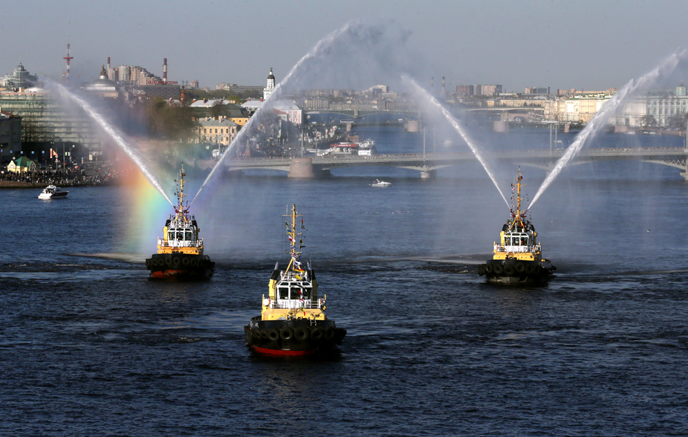 ST. PETERSBURG, RUSSIA. MAY 3, 2016. Tug boats dancing on the Neva River during the 3rd Icebreaker festival.