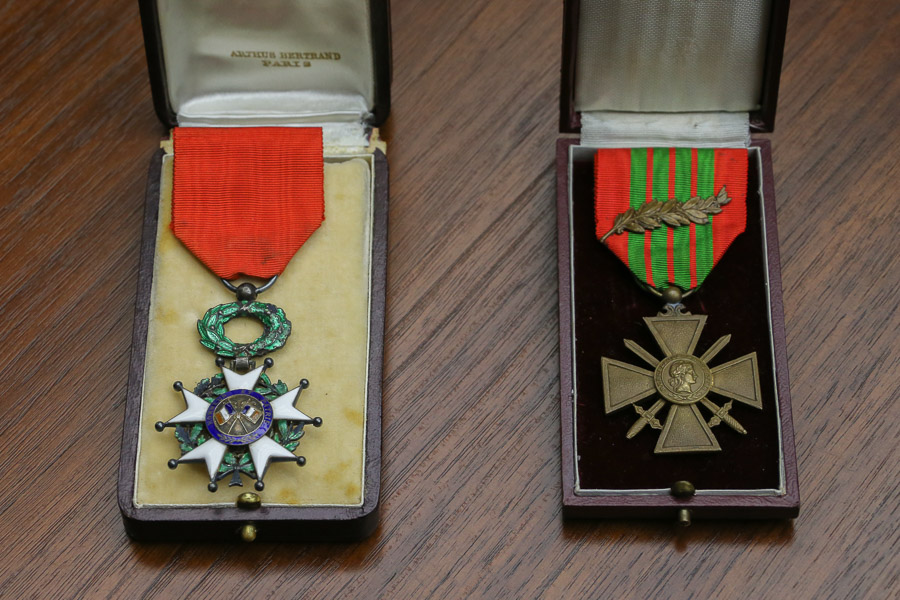 A Legion of Honor order and a Military Cross with palm branch.