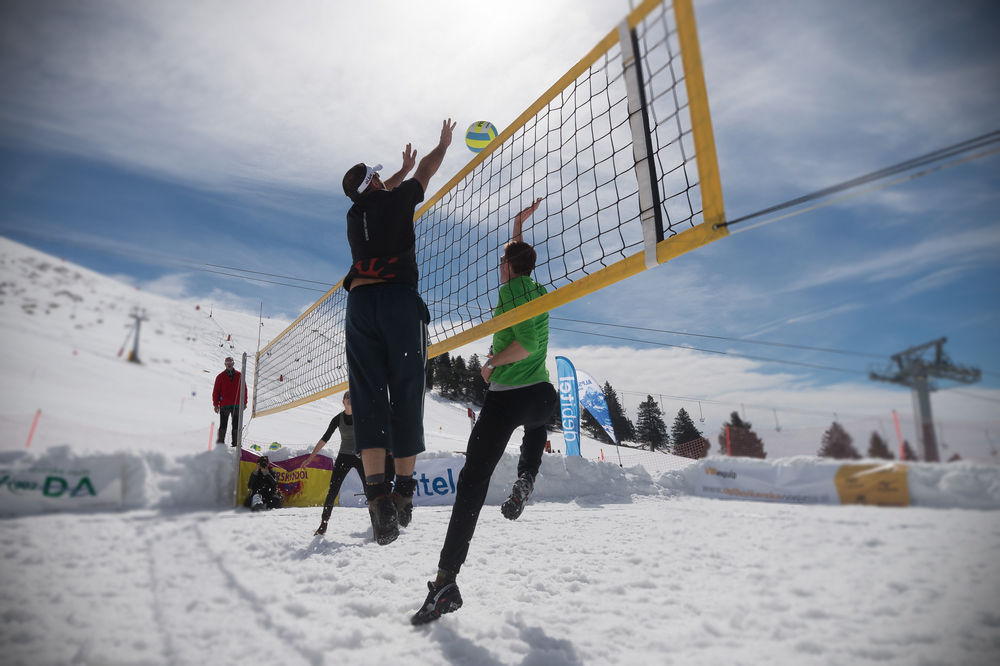 Players of volleyball in the snow.