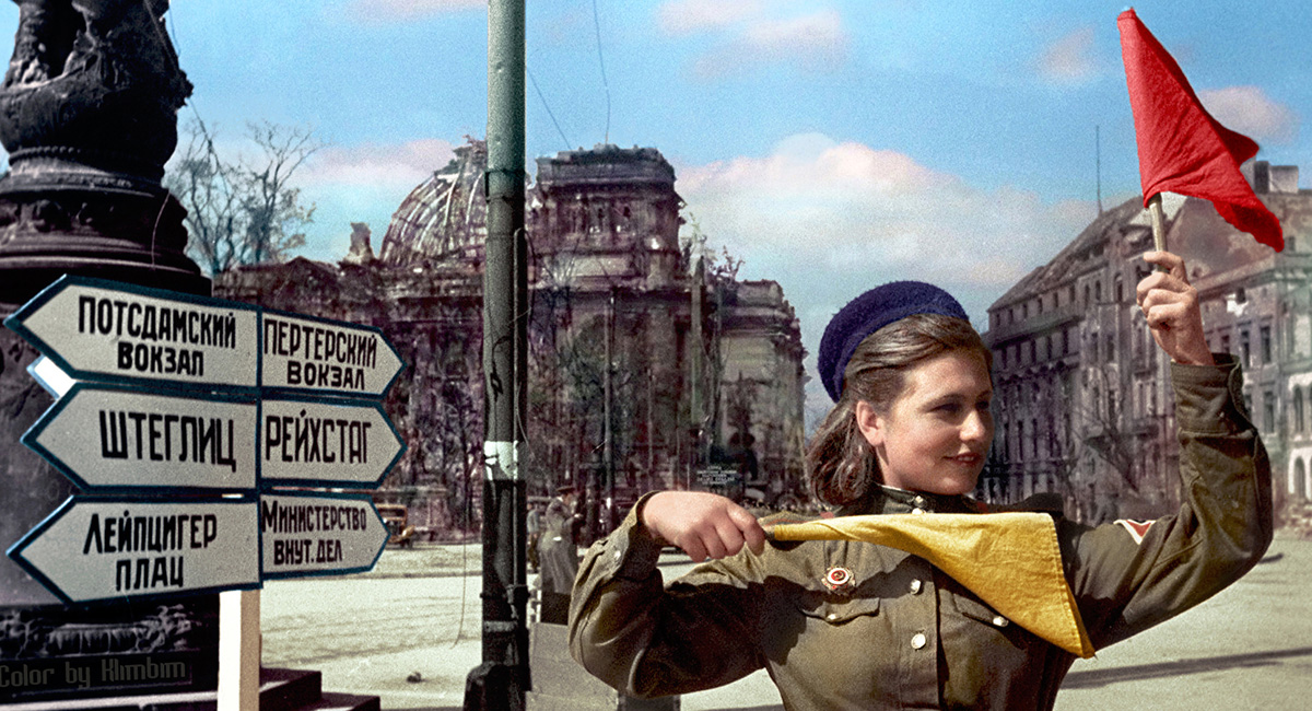 Red Army fighter Katerina Spivak controls traffic on the roads of Berlin, 1945.