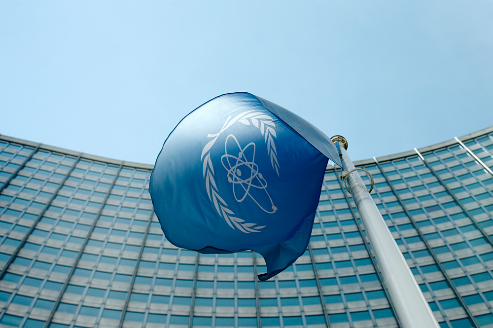 The flag of the International Atomic Energy Agency (IAEA) flies in front of its headquarters in Vienna, Austria.