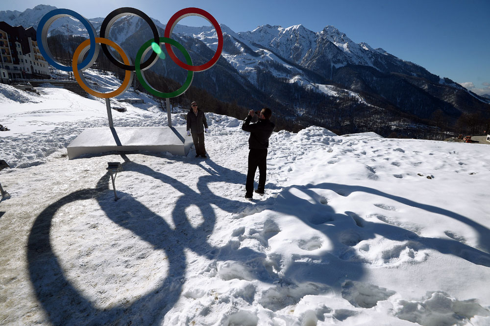 Guests posing with the Olympic rings in the main mountain Olympic Village in Sochi.