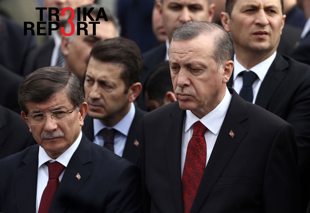 Turkey's President Recep Tayyip Erdogan, right, and Prime Minister Ahmet Davutoglu, left, arrive to attend funeral prayers for army officer Seckin Cil, who was killed in Sur, Diyarbakir Wednesday, in Ankara, Turkey, Thursday, Feb. 18, 2016.