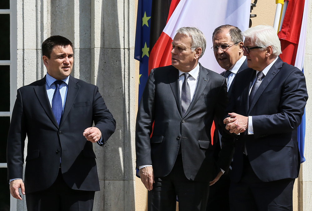 Ukraine's minister of foreign affairs Pavel Klimkin, France's minister of foreign affairs Jean-Marc Ayrault, Russia's minister of foreign affairs Sergei Lavrov, and Germany's federal minister for foreign affairs Frank Walter Steinmeier (L-R) at a Normandy Four meeting to discuss the situation in east Ukraine.