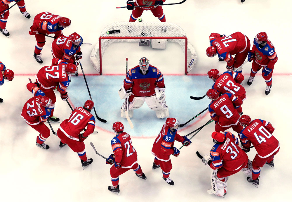 Russia's players gather around goalie Sergei Bobrovski prior to the Ice Hockey World Championships Group A match between Russia and Denmark, in Moscow, Russia