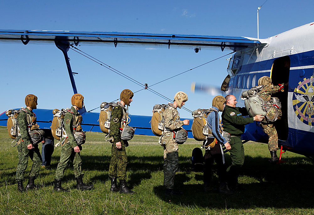 Students of the General Yermolov Cadet School board an airplane for a parachute jump at an airdrome in the village of Novomaryevskaya outside the southern city of Stavropol, Russia, May 13, 2016