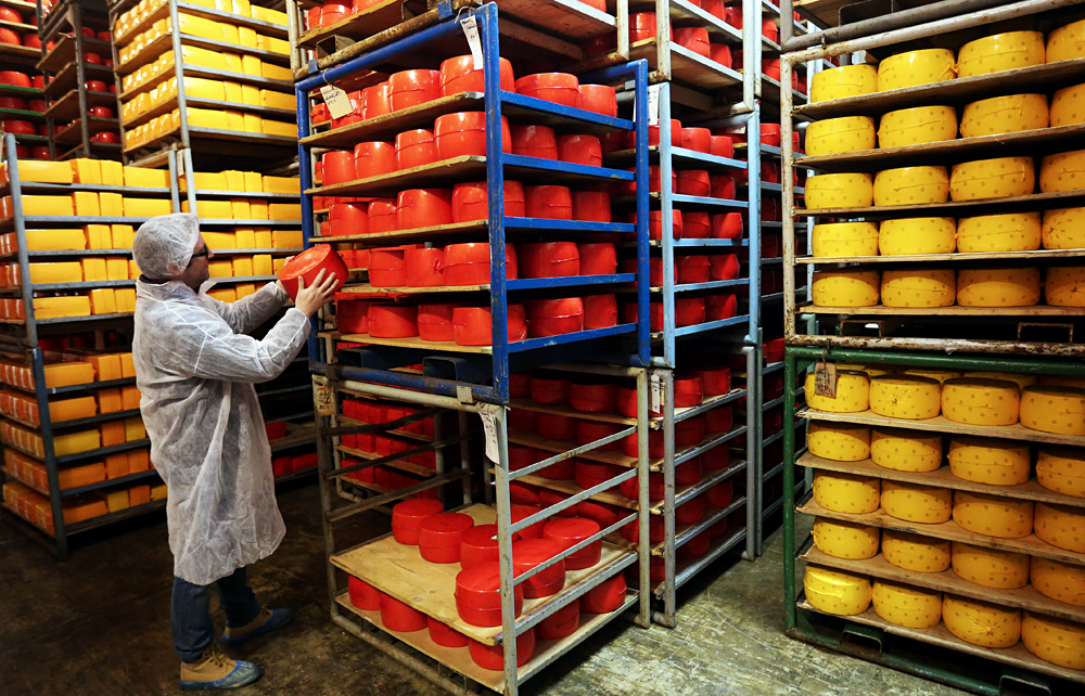 The German firm will purchase a number of cheese production facilities in Russia.