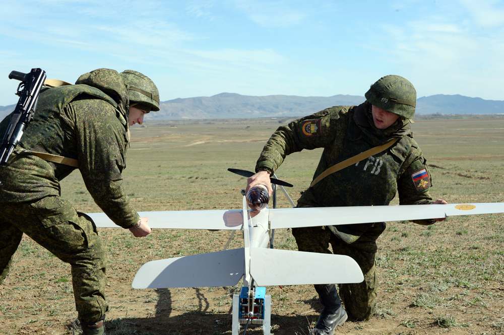 Servicemen prepare a drone for launch during a drill of the Southern Military District troops.