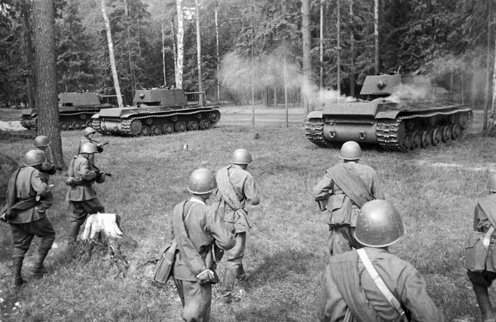 Soviet troops following heavy KV tanks.