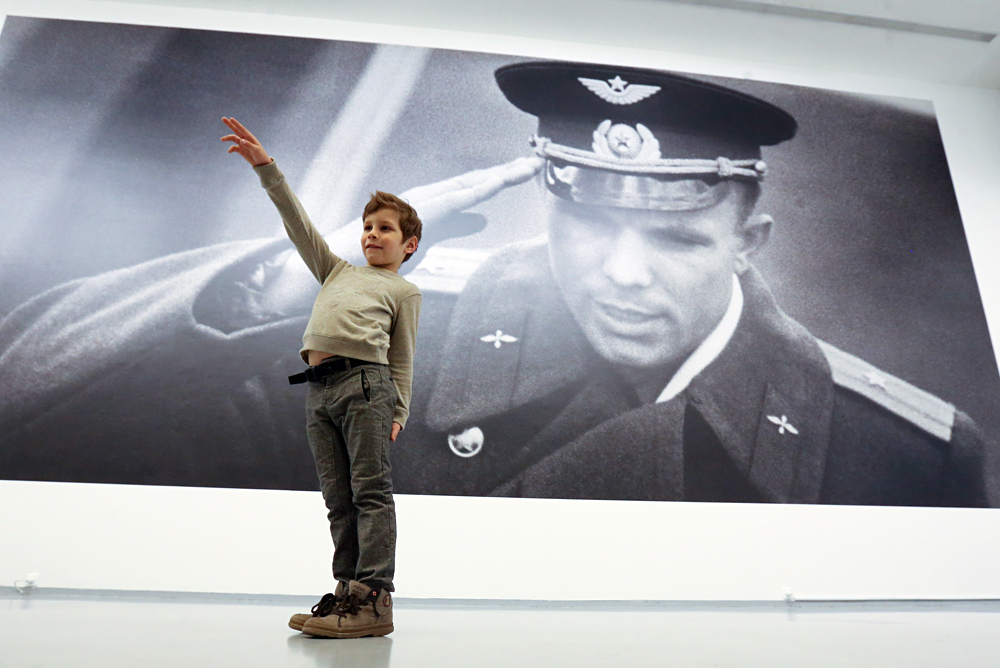 "A boy attends an exhibition titled ""Russian Space"" marking the 55th anniversary of the first manned space flight, at the Multimedia Art Museum in Moscow, Russia, May 17, 2016. On April 12, 1961, Soviet cosmonaut Yuri Gagarin became the first man in space when he orbited the Earth aboard Vostok 1."