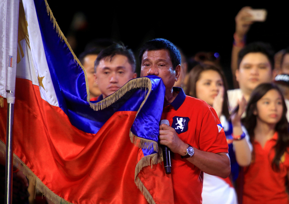 President-elect Rodrigo Duterte kisses the Philippine flag in Manila, Philippines.