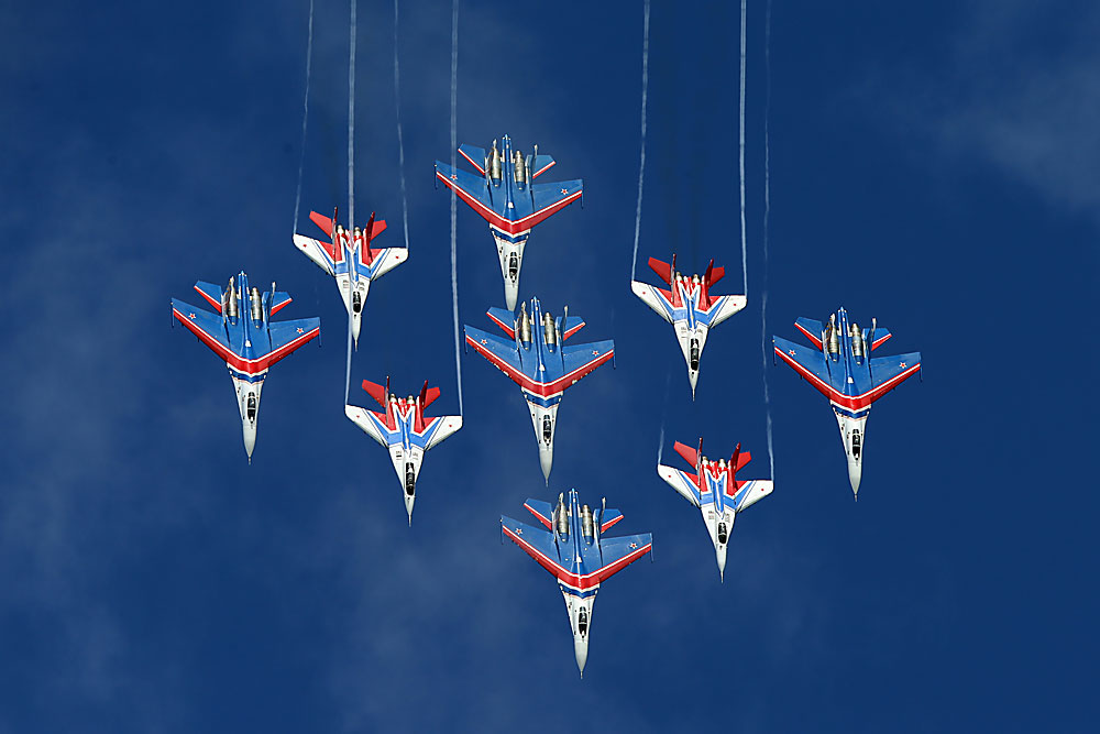 Mikoyan MiG-29 fighter jets of the Strizhi [Swifts] and Sukhoi Su-27 fighter jets of the Russkiye Vityazi [Russian Knights] perform during an event marking the 25th anniversary of the Swifts and Russian Knights aerobatic teams, at Kubinka air base in the Moscow Region on May 21.Read more: 5 incredible aerobatic maneuvers by the Russian Knights