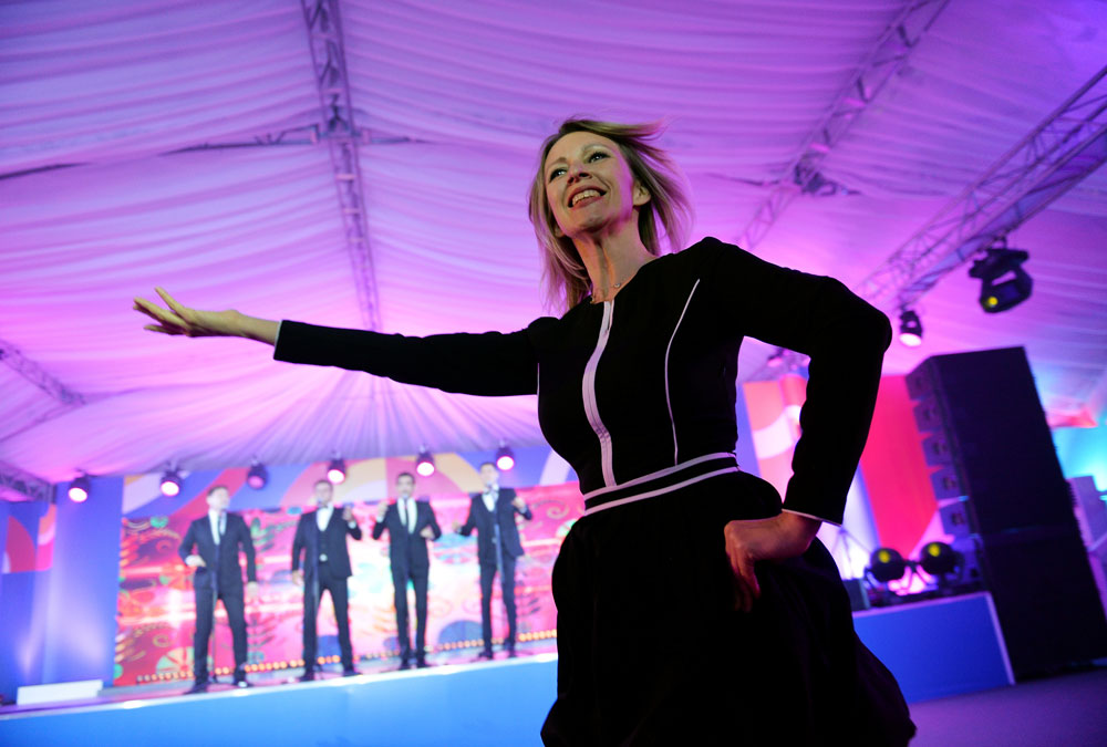 Russian Foreign Ministry spokeswoman Maria Zakharova dances during the reception in honour of heads of the delegations at the Russia-ASEAN summit in Sochi.