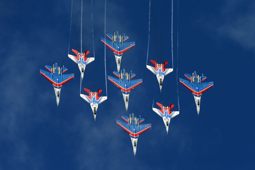 Mikoyan MiG-29 fighter jets of the Strizhi [Swifts] and Sukhoi Su-27 fighter jets of the Russkiye Vityazi [Russian Knights] aerobatic teams perform during an event marking the 25th anniversary of the Strizhi [Swifts] and Russkiye Vityazi [Russian Knights] aerobatic teams, at Kubinka air base in the Moscow Region, Russia