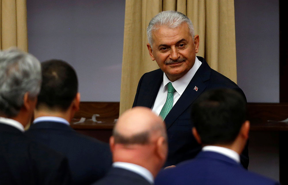 Binali Yildirim attends a debate at the Turkish parliament in Ankara.