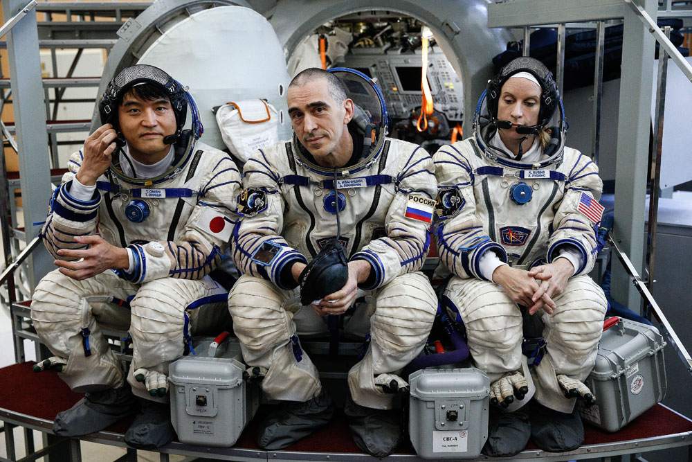 Expedition 48/49 main crew members, austronaut Takuya Onishi (JAXA), cosmonaut Anatoly Ivanishin (Roscosmos), and astronaut Kathleen Rubins (NASA), from left, in spacesuits training for the upcoming mission to the International Space Station, at the Yuri Gagarin Cosmonaut Training Centre in Zvyozdny Gorodok, Moscow Region. The launch of Expedition 48/49 aboard the Soyuz MS-01 spacecraft to the ISS is scheduled for June 2016