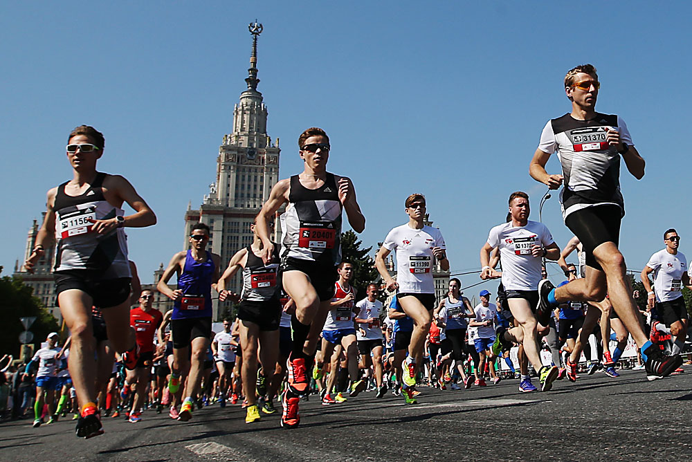 Participants in Running Hearts, a charity race on Moscow's Vorobyovy Hills (Sparrow Hills) organised by the Naked Heart Foundation, near the main building of Moscow State University.
