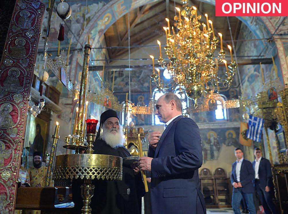 Russian President Vladimir Putin during a prayer service at the Assumption Cathedral.