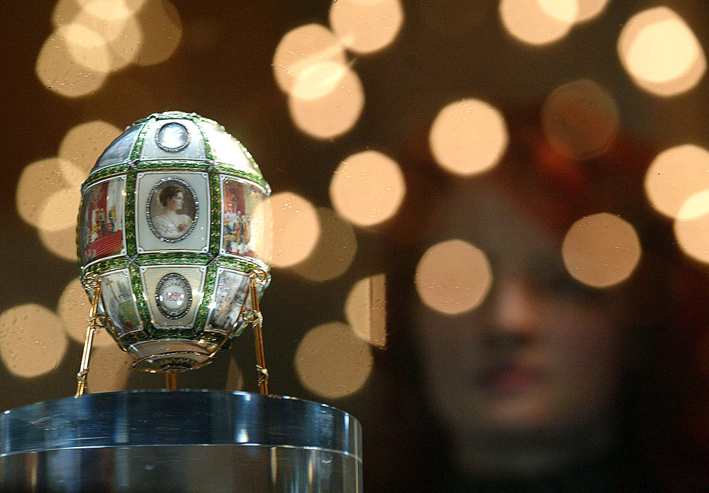 A visitor admires the Egg by Faberge, presented by the Russian Czar Nikolas II to his wife in 1911, during an exhibition in the Kremlin in Moscow.