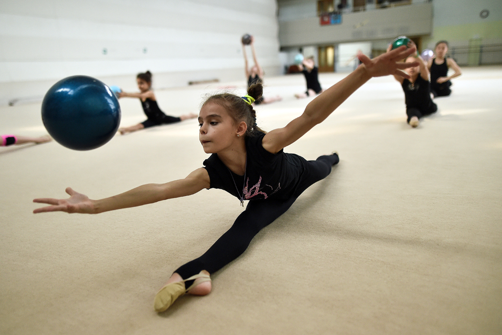 Young girls train with a ball in MGFSO Olympic reserve school in Moscow