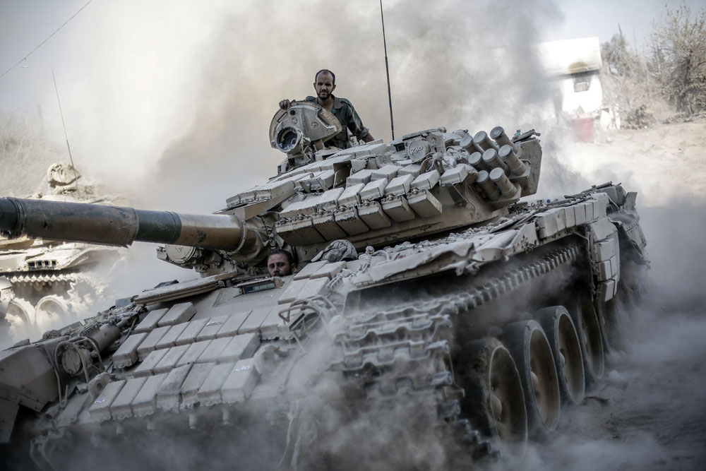 Tthe T-72 tank will be fitted with reactive armor tiles on all sides. Pictured: Syrian Army soldiers fight insurgents in Jobbar, a suburb of Damascus.