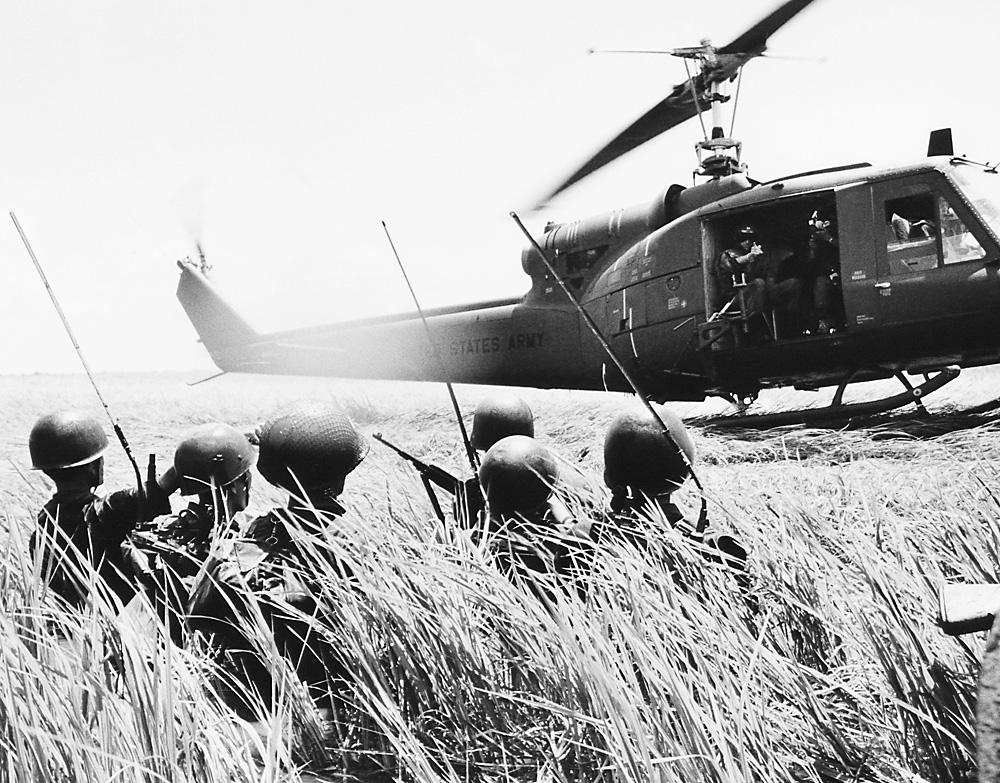 A Vietnamese troop reconnaissance unit walks hip-deep in water towards helicopter in the Mekong Delta on Oct. 13, 1964.