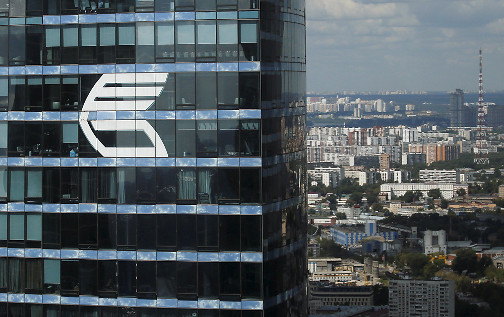 The logo of VTB Group is seen through a window of Imperia Tower on a facade of the Federatsiya Tower at the Moscow International Business Center.