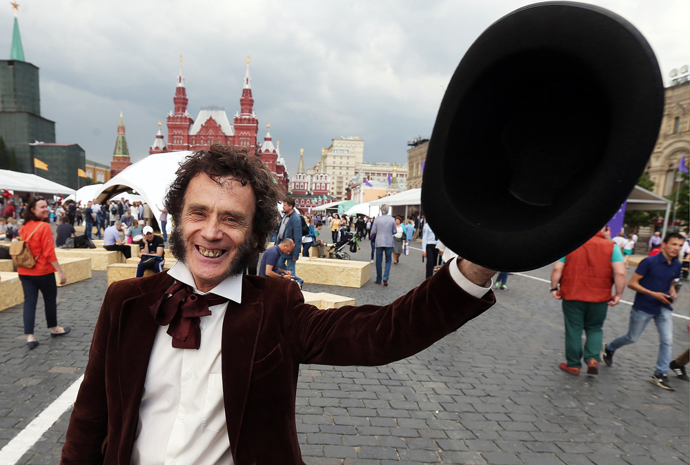 A man dressed as Russian poet Alexander Pushkin attends the opening of the 2016 Red Square Book Festival. Moscow