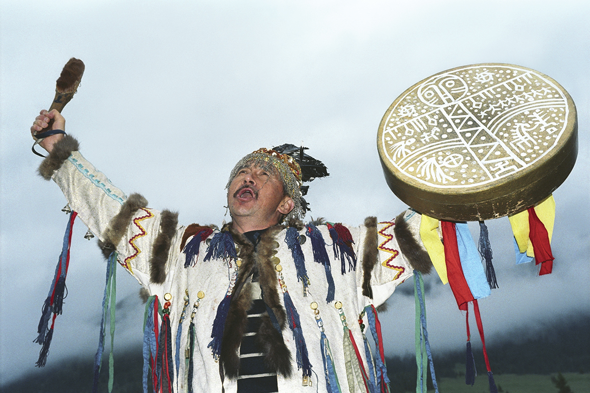 A shaman performs a ritual dance with a tambourine at the El-Oiyn folk festival. Some Russian regions, such as Altai, Khakassia, Tuva, and Yakutia, still have a strong belief in shaman power.