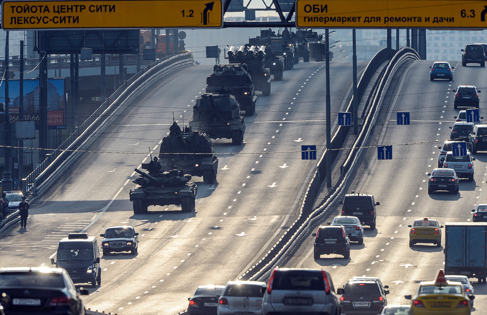 Military vehicles drive on Moscow streets before a night rehearsal of the Red Square parade marking the 71st anniversary of the Victory in the Great Patriotic War