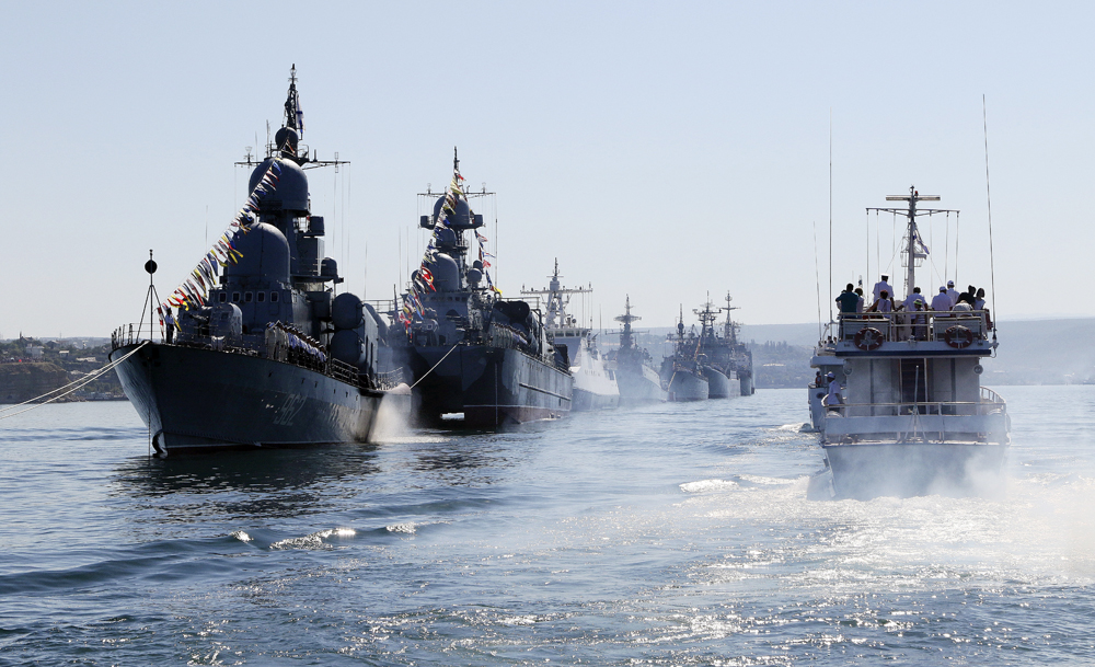Russian warships are seen during a rehearsal for the Navy Day parade.