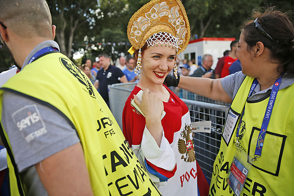 A Russian soccer fan smiles as she enters Marseille's Stade Velodrome ahead of the Euro 2016 in France Group B soccer match between England and Russia on June 11, 2016.Read more: Euro 2016: Russia vs. England – who will win the battle?