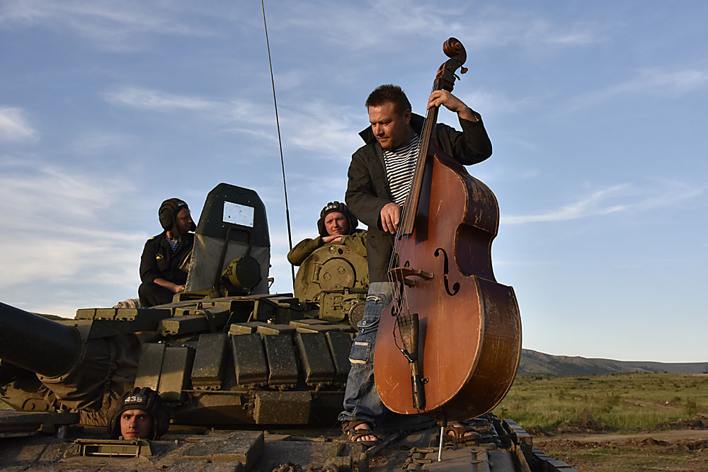"A musician plays a double-bass during a patriotic festival, ""Chronicles of Crimea. Episode 2016: What Fatherland Starts With?"", held at the Angarsky training field in Zarechnoye settlement, Crimea."