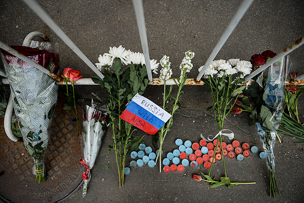 Flowers left outside the US Embassy in Moscow in memory of those killed in the night club shooting in Orlando.