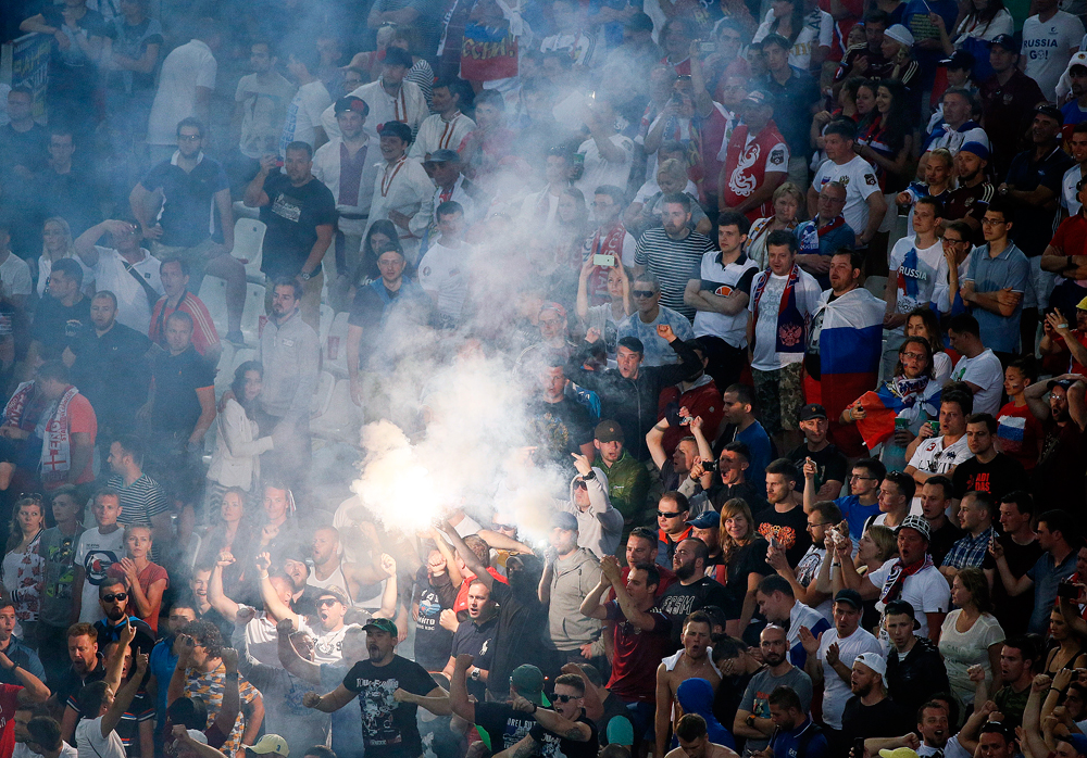 Russia's soccer fans burn flares during the England-Russia match, June 11, 2016.