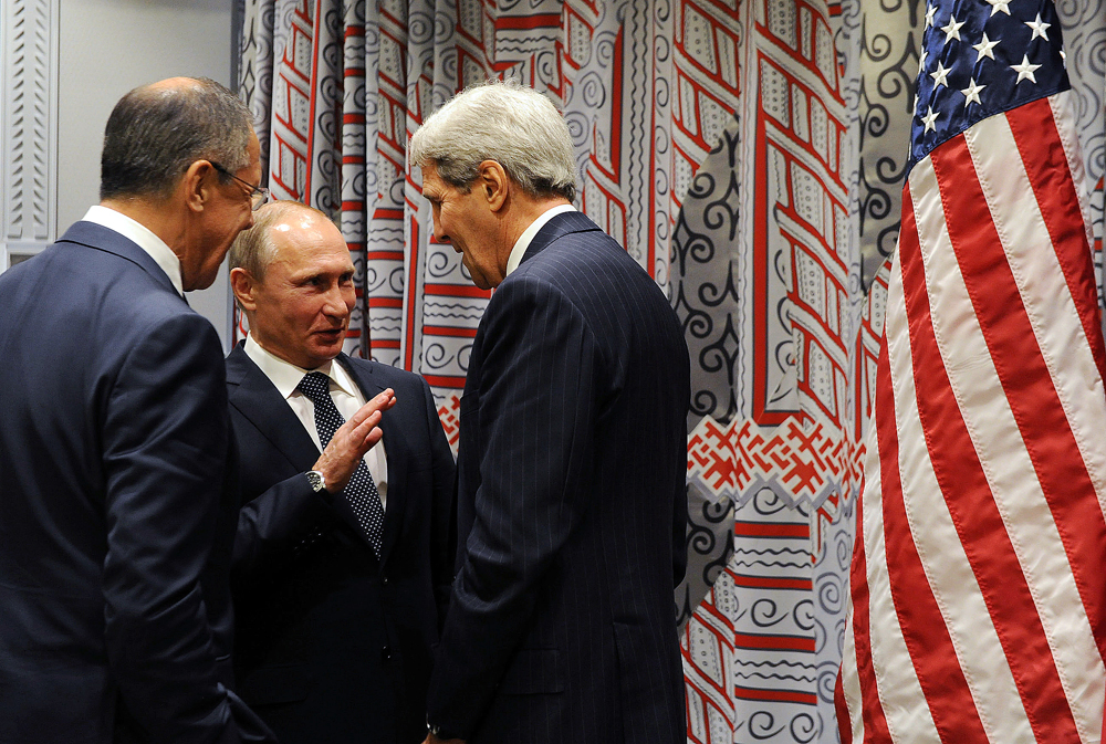 Russia's Foreign Minister Sergei Lavrov, Russia's President Vladimir Putin and US Secretary of State John Kerry talking after Putin's meeting with US President Barack Obama on the sidelines of the 70th session of the United Nations General Assembly, September 28, 2015.