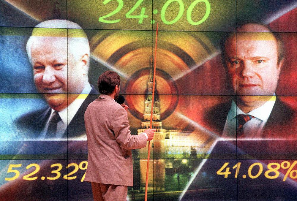 Nell'immagine, Boris Eltis (a sinistra) e Gennadij Zyuganov con le rispettive percentuali dei voti ottenuti alle elezioni del 1996.