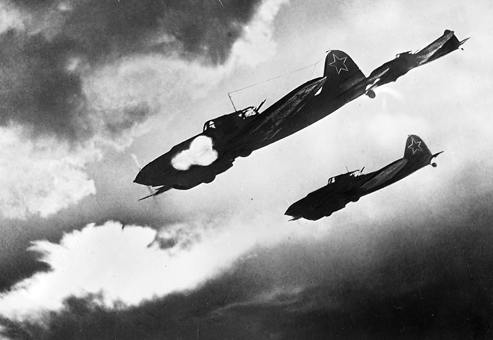 "Soviet Il-2 planes, dubbed the ""Flying Tank"",  attacking a Nazi column. The Kursk Bulge. The Voronezh Front."