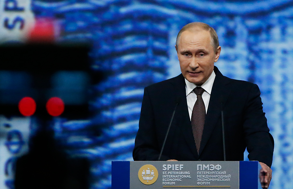 Russian President Vladimir Putin delivers a speech during a session of the St. Petersburg International Economic Forum 2016, June 17, 2016.