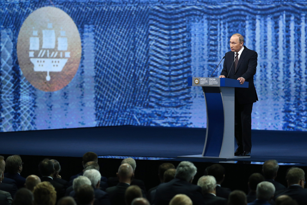 "Russian President Vladimir Putin addresses a plenary session titled ""Capitalizing on the New Global Economic Reality"" as part of the 20th St. Petersburg International Economic Forum, June 17, 2016."
