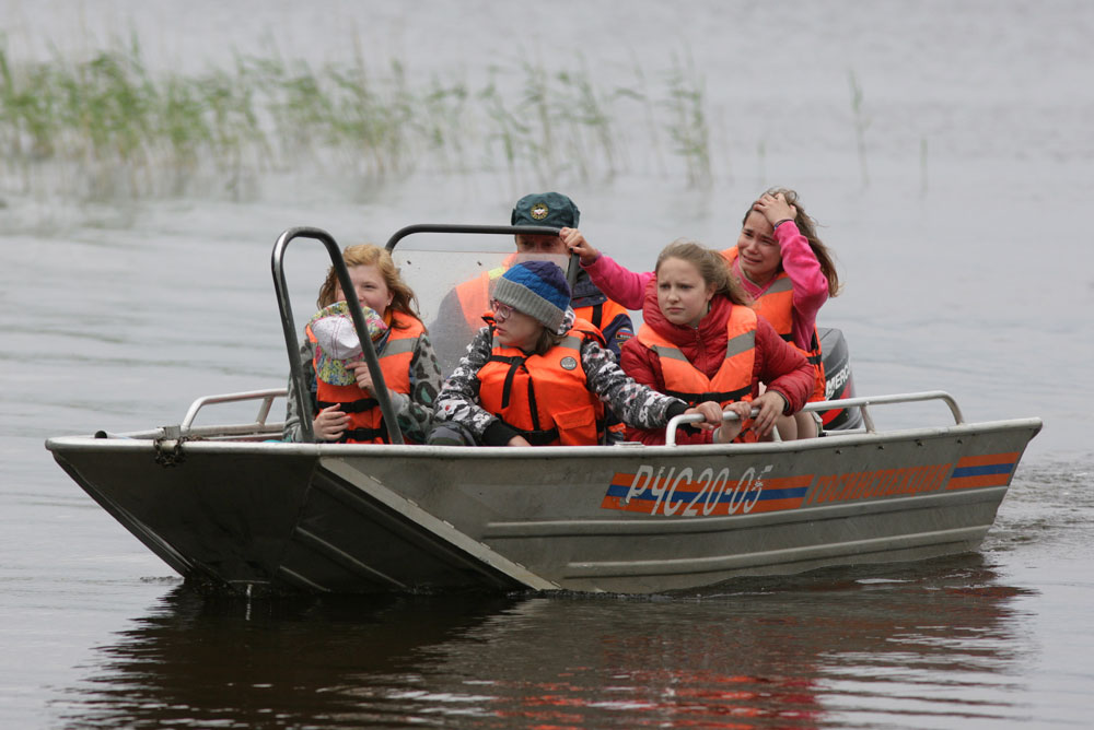 KARELIA, RUSSIA – JUNE 19, 2016: Kids return to the Syamozero Park Hotel in the Pryazhinsky District. At least 10 children from Moscow and one adult died in the early hours of June 19 as storm hit a tourist boat on Lake Syamozero.